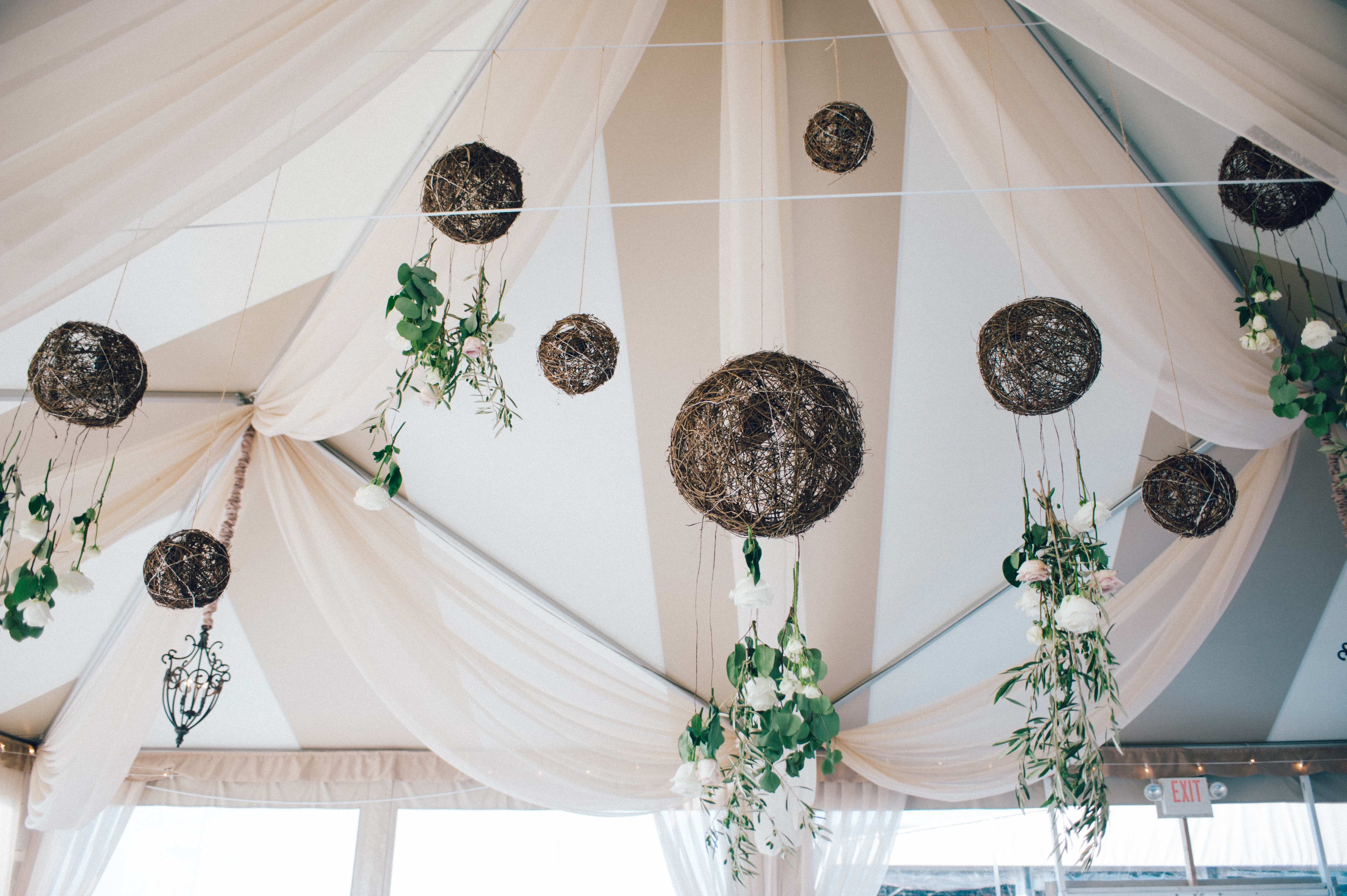 flou(-e)r Specialty Floral Events Ocean Cliff Tented Beach Wedding Floral Chandelier