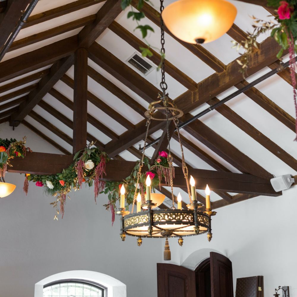 Create a stunning wedding with hanging floral arrangements flou e reception with floral chandeliers hanging wedding dcor will help define your space and bring about an important design element to your special day arubaitofo Image collections
