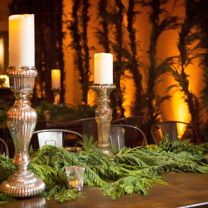 flou(-e)r_specialty_floral_events_holiday_decorating_candles_greens