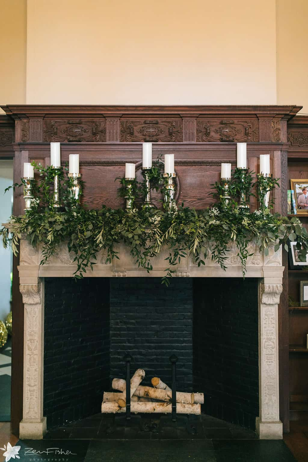 wedding fireplace candles and flowers