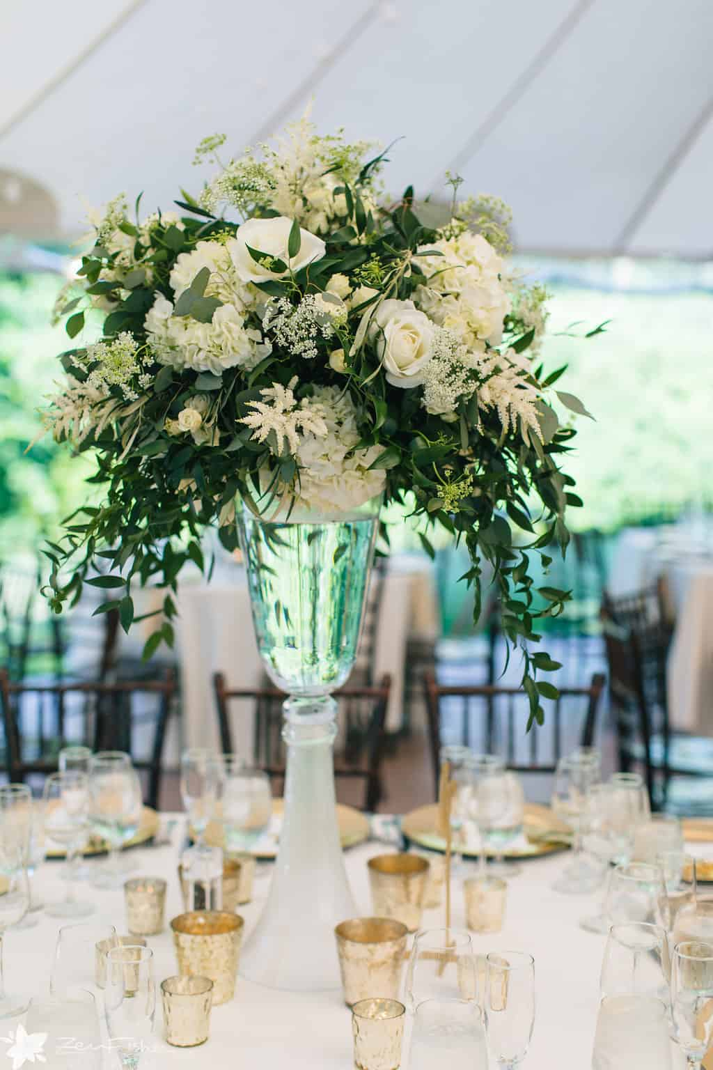 tall green and white wedding centerpiece