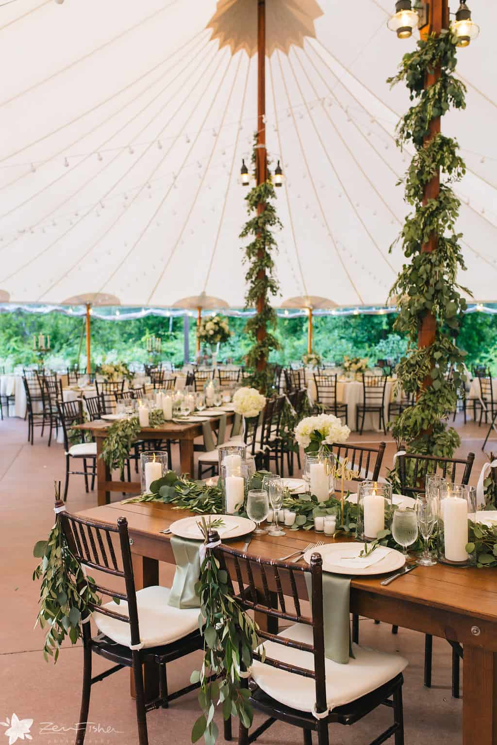 greenery wrapped tent poles