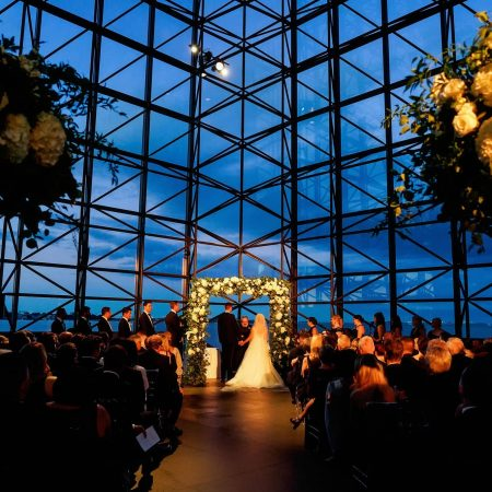 Jewish Wedding Chuppah adorned with Greenery and White Floral at JFK Library in Boston