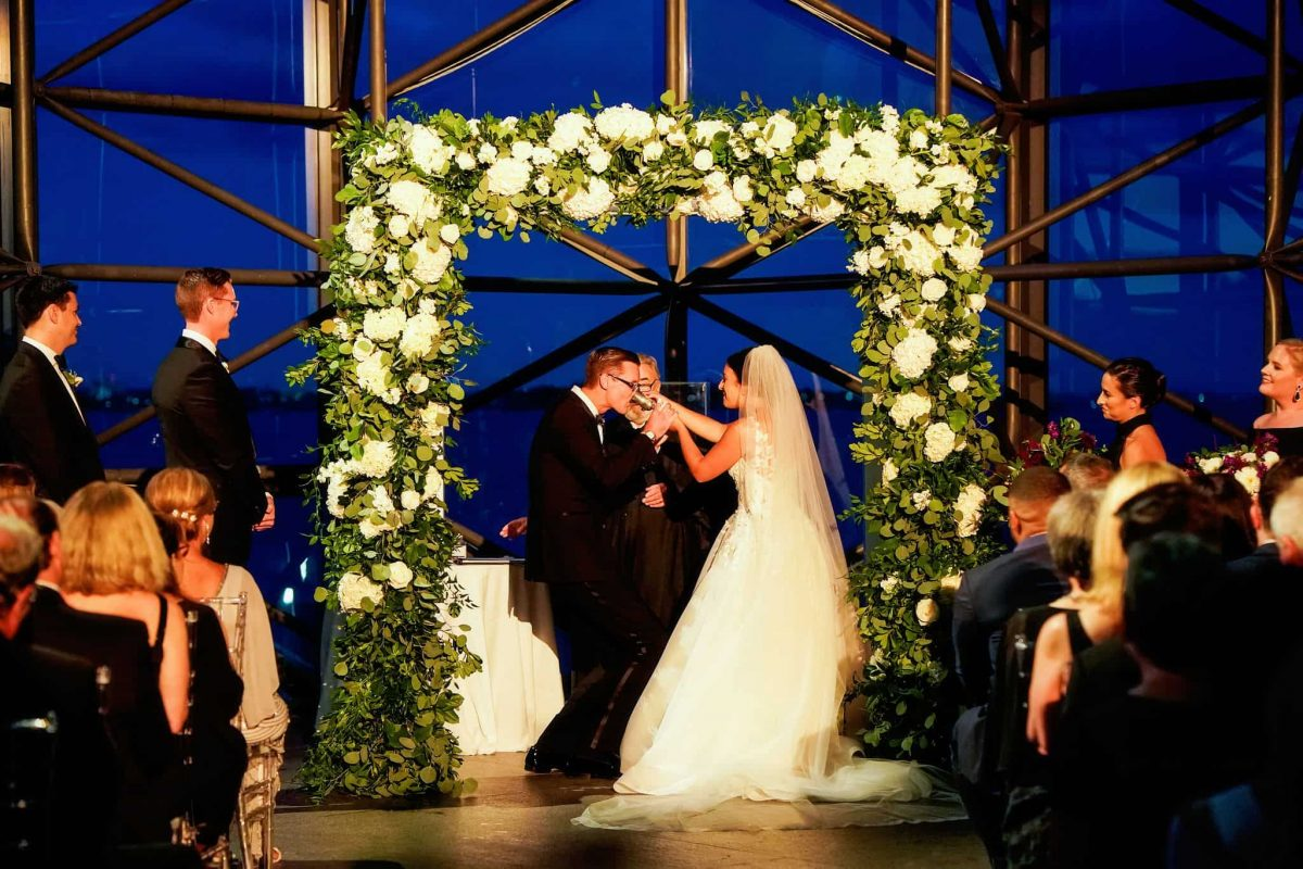 Floral wedding chuppah of greenery and white flowers
