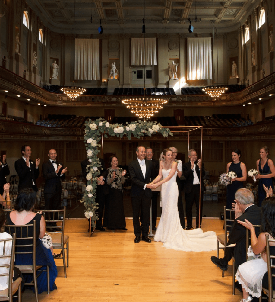Asymmetrical copper wedding chuppah at Boston Symphony Hall